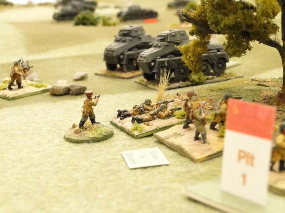 Taking a chance when the recce bonus card comes up, they make a dash through the Russian infantry lines. Should have had them on overwatch. Just hoping the armoured car comes up before Tea Break.