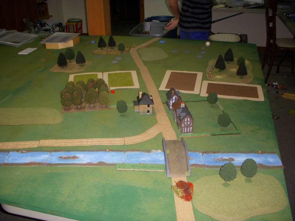Looking from the German side...squads placed in the orchard, the hedges, and the woods on the front right