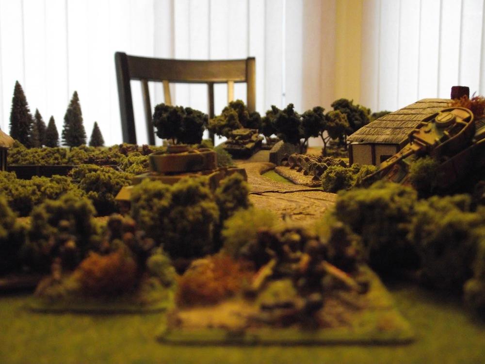 The PaK40 spots the lead Cromwell crossing the bridge.