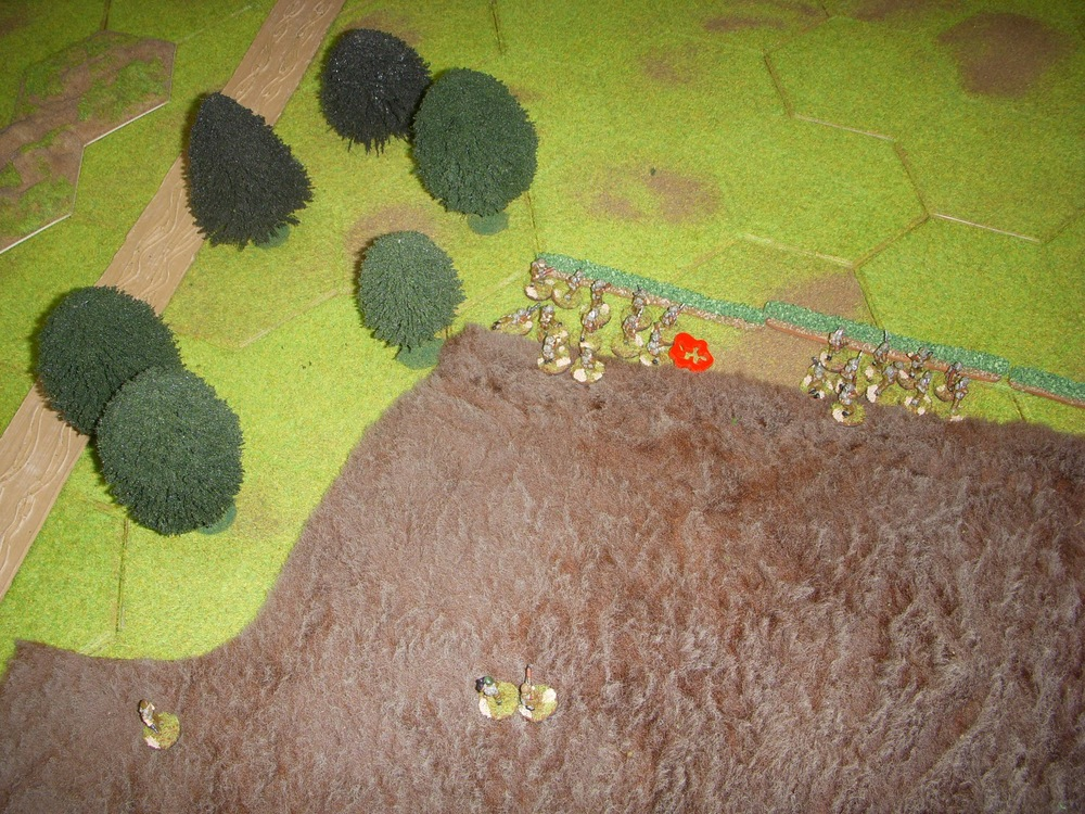 They start taking casualties from the MG in the stone farmhouse on the hill.