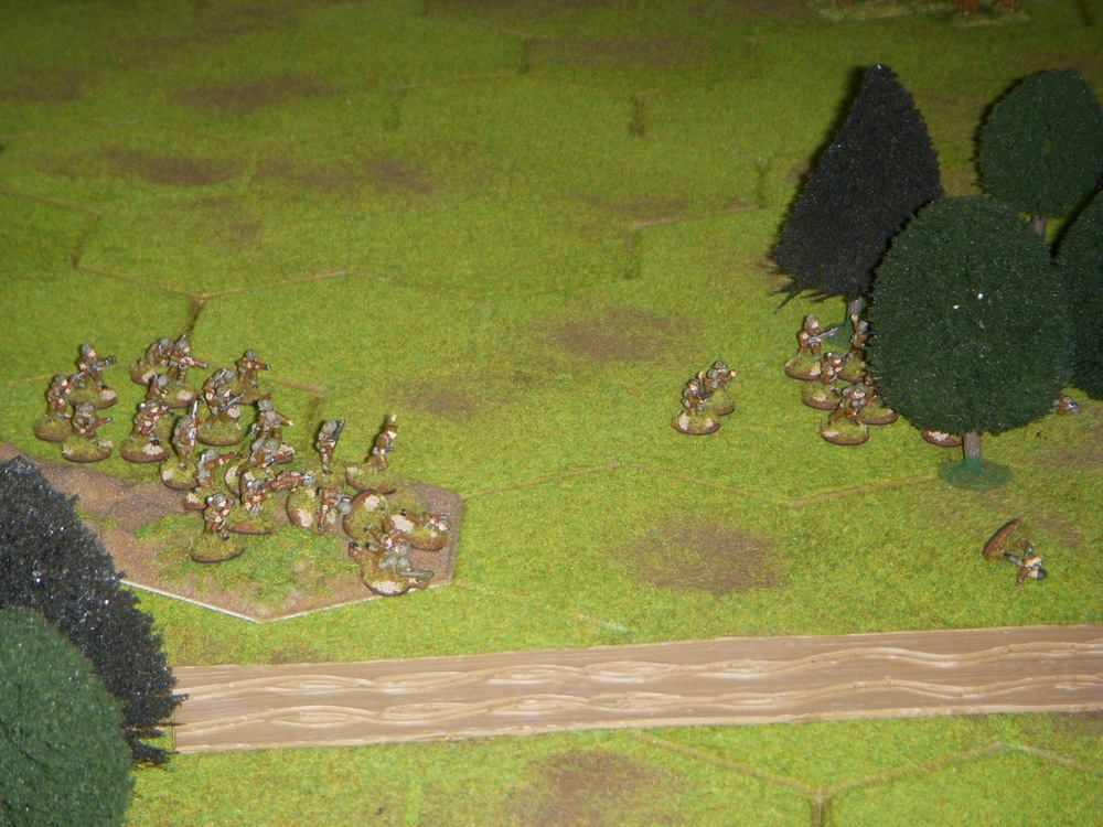 Meanwhile, 2nd Platoon has advanced on the left flank and entered the woods after flushing out the lone German squad