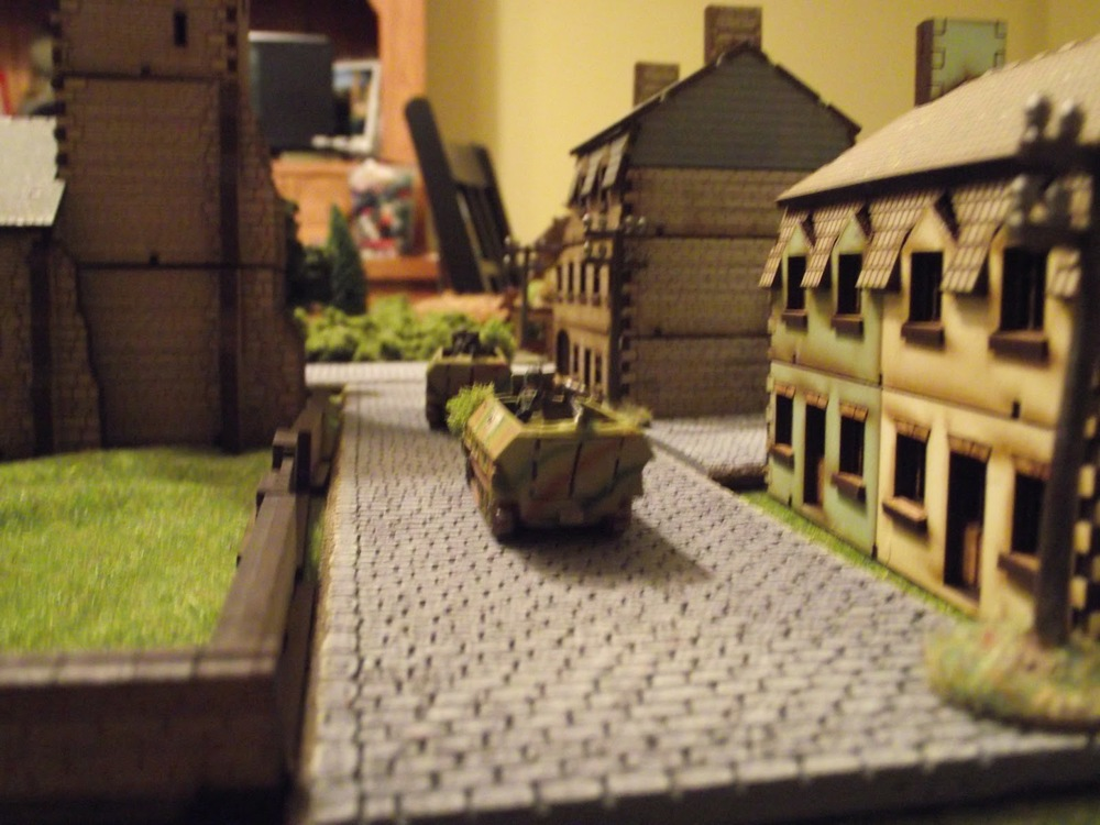 A close up of some of the SS men using the Churchyard as cover, and their transport.