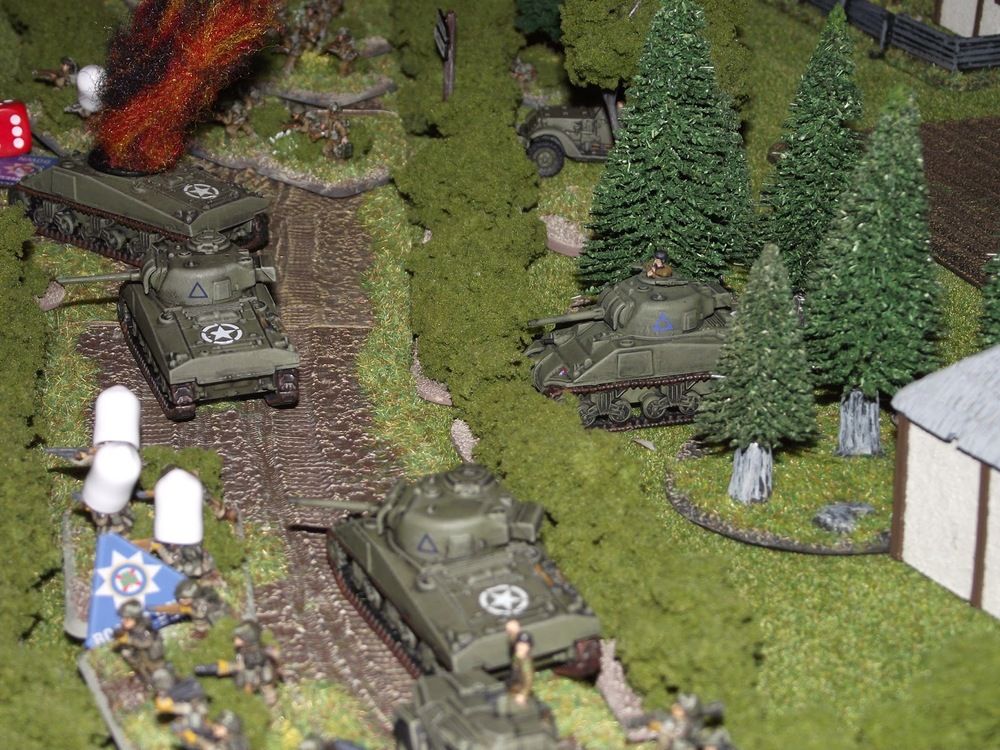 "The heavy fire is starting to cause a traffic jam on the dirt road. The lead Sherman, with his 75mm gun knocked out, withdraws back and out of the way. Not much point it losing a tank just for the sake of losing it. My wife asked ""why don't I just use its MG's or use it as cover by another unit?"" and my reply was ""that they wanted to live"", thus the most historical thing would be that it withdrew."
