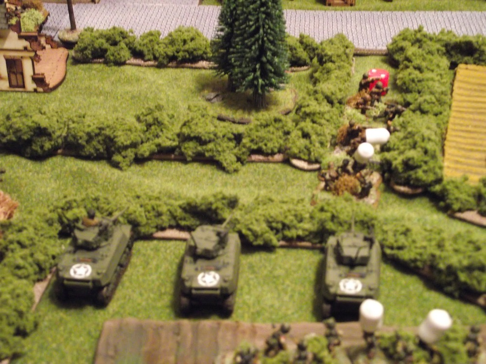 Stuarts wont be stopped though, and lay into some Germans with a flank shot using HE.... 4 Germans dead.
