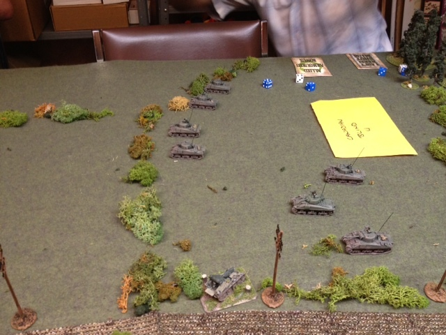 Allied armour advances on the right.