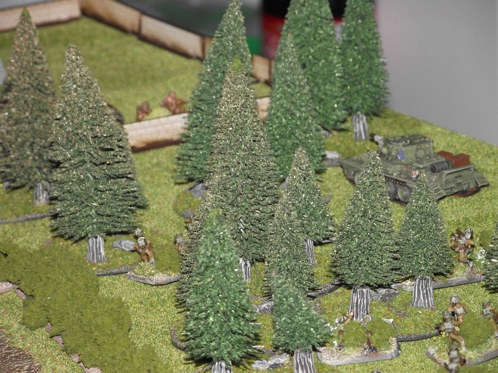 David's recce Cromwell starts its slow push towards the court yard of the church. His infantry not far behind.