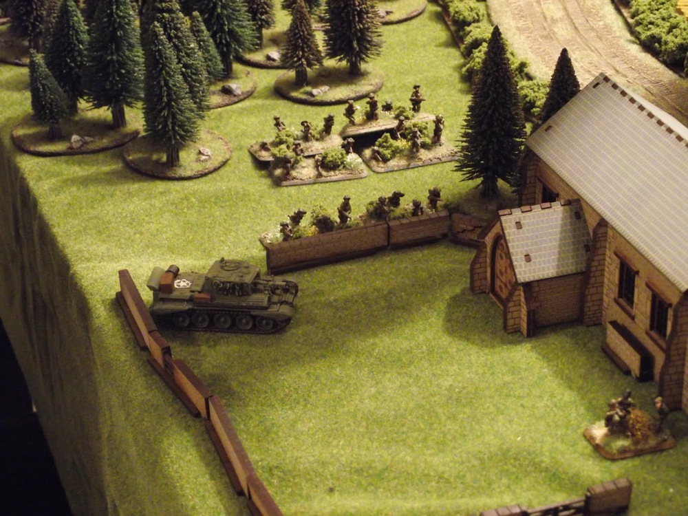 Cromwell breaks down the wall and gets ready to pound the SS infantry who have taken shelter inside.