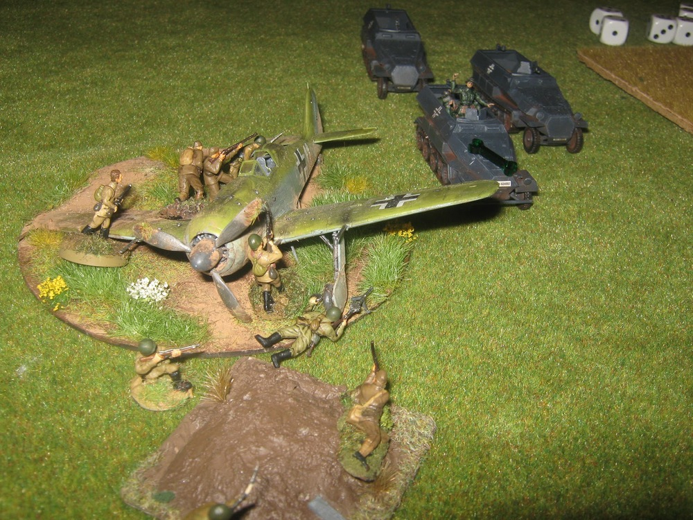 Next in to be spotted is a platoon of grenadiers in halftracks. Oops, Russkies hidden around the downed fighter. They fire at point blank range and damages the Hanomag.