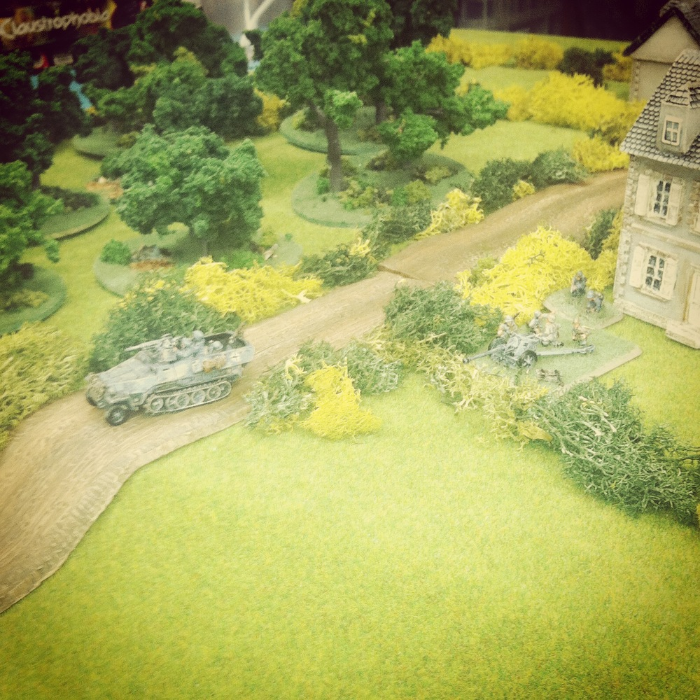 A German Pak 40 and Sdkfz 10/1 break their cover on Hill 91 to engage the paralyzed American column