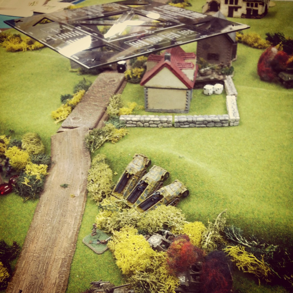 Flares illuminate the town objectives and German mechanized Grenadiers push forward