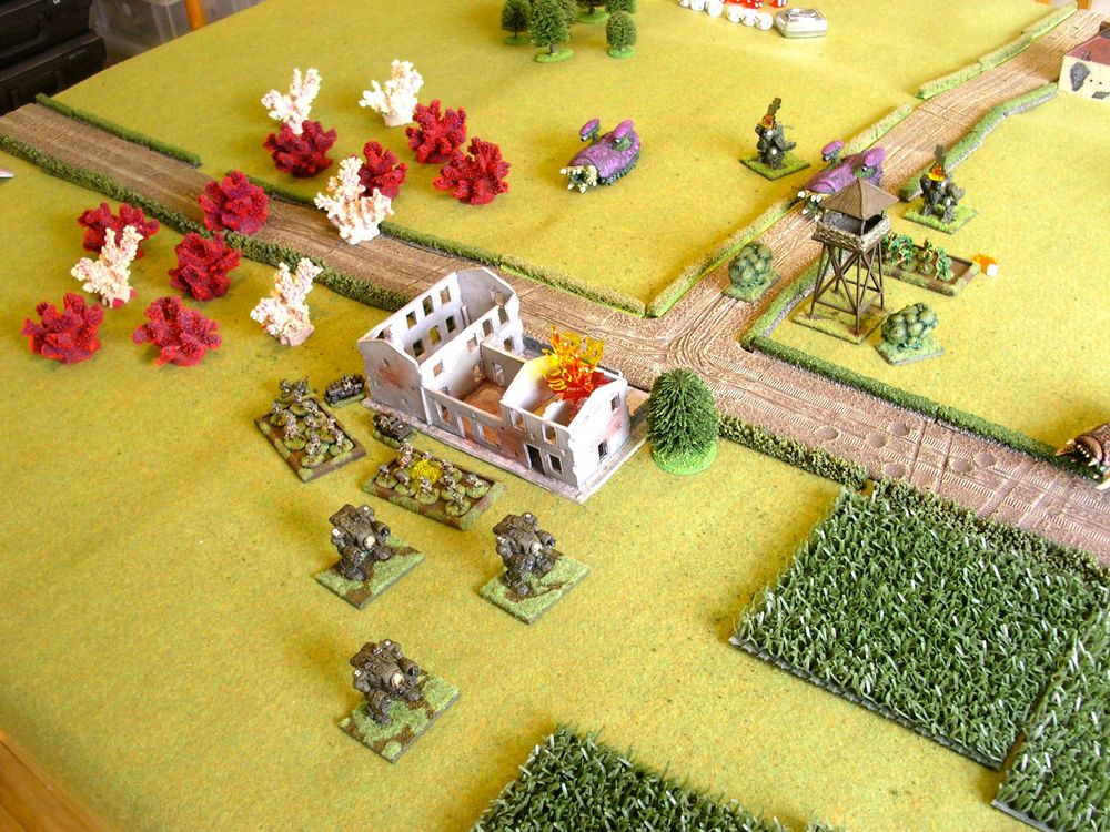 airborne troops flee the flaming farm