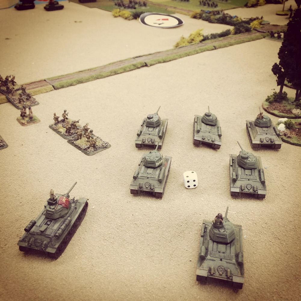 T-34s try to push from the right using the forest as cover
