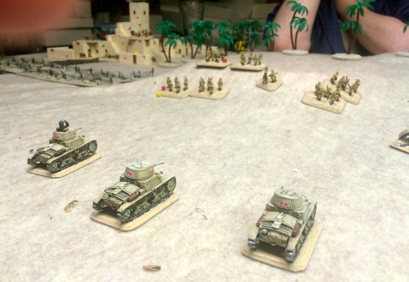 Here my fearless Italians advance on the British left flank, after taking out an unfortunate pair of 2pdr ATGs with a barrage of HE tank fire.   Everyone's had their double espresso and almond biscotti and are feeling molto avanti.