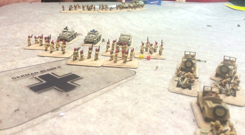 James sends his force at the British centre, unlimbering his AT guns to hold the flank against the British armour we suspect is lurking in the sand dunes.