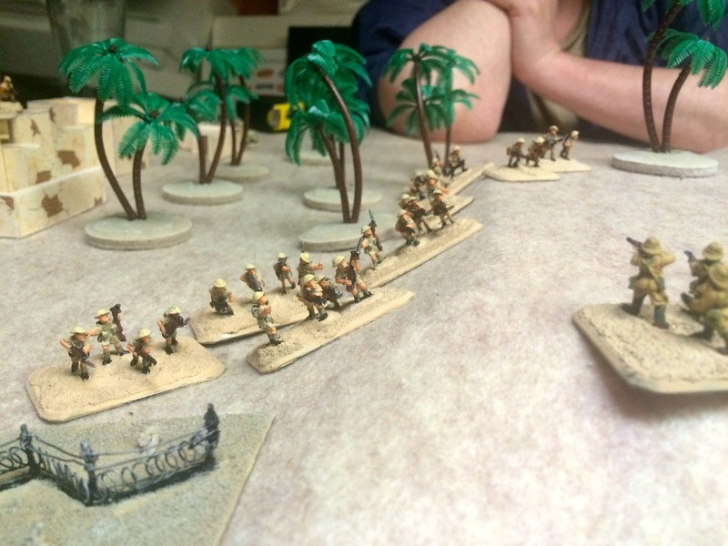 Another surprise!  Barry's infantry come charging out of the village to rip into my advancing platoon.   The melee goes for badly for my latter day legionaires and the survivors are sent packing.  Nice offensive spirit by Barry.