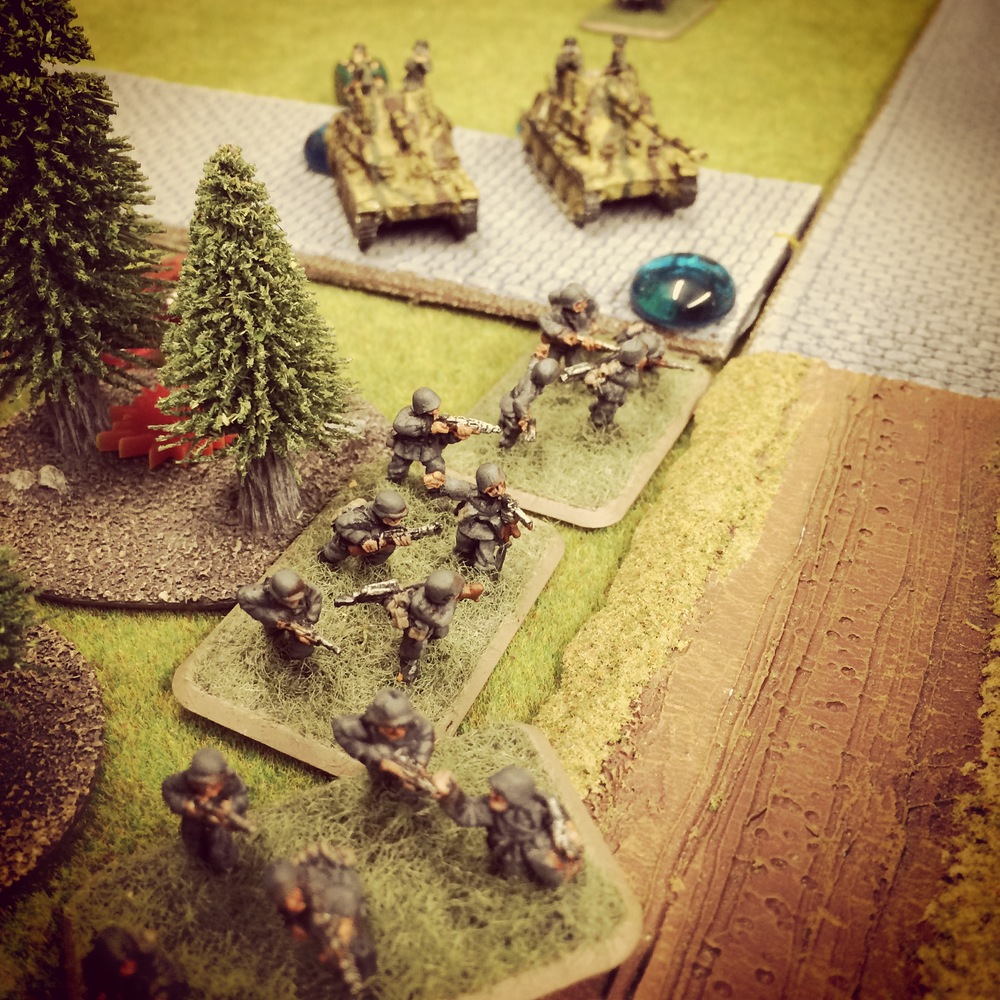 Germans swarm out of the woods toward the British defenders