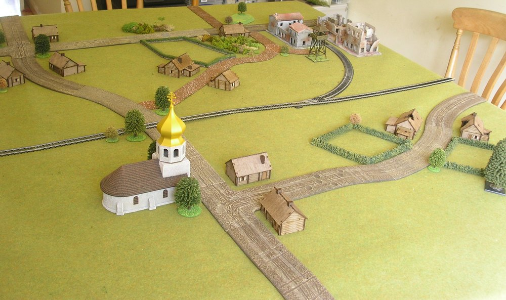 Soviets deploy anywhere to the right of the main road running past the church. germans attack from the left. railway yard is top right.