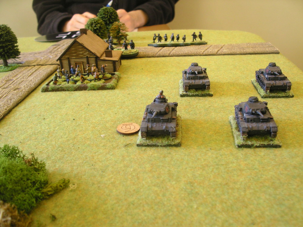 German Big Man Six leads his tanks forward