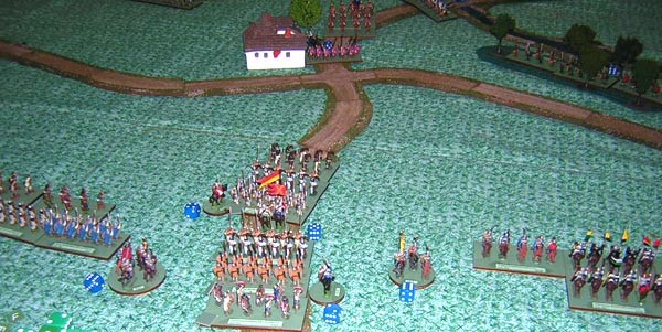 Ed Sansing's infantry moves up the road. On the left Travis' infantry. On the right Mark Gilbert's cavalry. Note the blue command point dice next to each command stand. This is a reminder of how many command points each officer received at the start of that turn. This is the number of units that he can motivate.