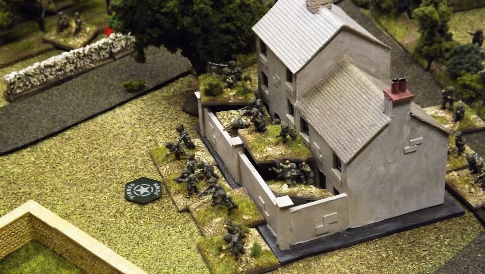 The German MG42s returned the compliment of the US firepower. The first house taken by Beall's close assault