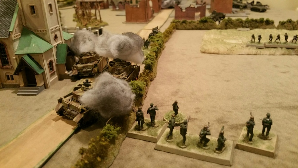 Left flank road around the church is blocked with burning wreckage but German infantry turns the position, defeats the American platoon, and pushes into town.