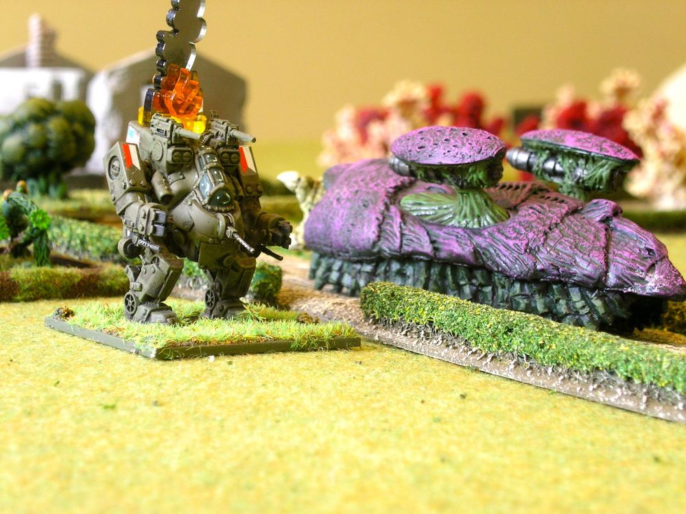 Vornid Chitin Bio-Tank moves past a KO'd walker