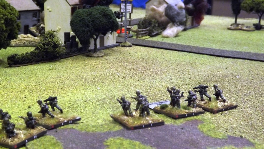 With Baskeyfield and his men dead and wounded around their gun, top right, SS Sturmscharfuhrer (RSM) Artur Spengler moves his first first zug around the British right flank and comes under small arms fire from the buildings. German mortar fires starts to land on the buildings to their right.