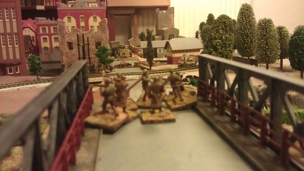 One squad vs an 88, a StuG, a Stummel and assorted infantry.