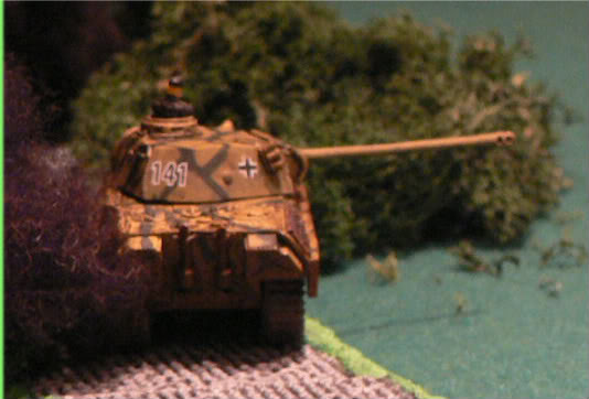 Up on the road the Panther starts firing in to the woods