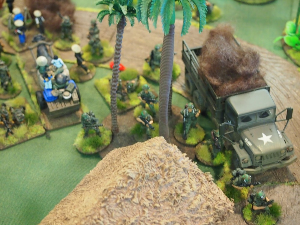 Platoon one section three finally making its way into the village with flamethrower support
