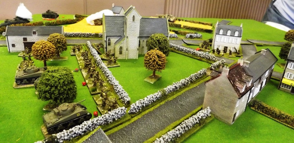 The Canadian attack is relentless with their infantry holding the centre of the village and their armour in support