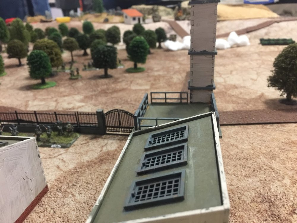 View from over the olive pressing plant. The other troop of the 16th/5th has already lost its CO to the Stug - the double 6 to hit (and thus bonus 3 dice) doing most of the damage there. The brewed-up Sherman can be seen in the distance just to the left of the chimney.  The smoke laying job has been taken over by 1 Platoon up in the cutting on the hill behind the single house, as 3 Platoon's mortar team just got cut in half by two MG34s.