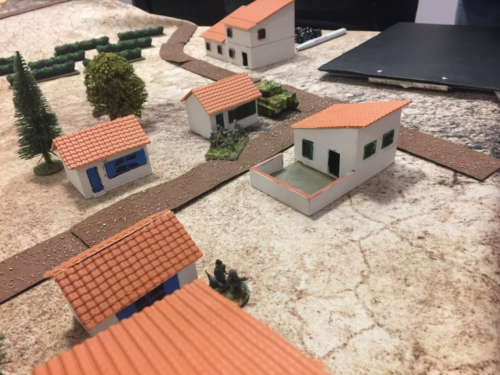 The 'Tiger' lurking behind a house. (The roof material is Wills 00 pantile sheet). Also visible one of the German MG teams and the overall German CO. And some Battlefront vineyards, with a heavy ink wash to hide the hideously bright green!