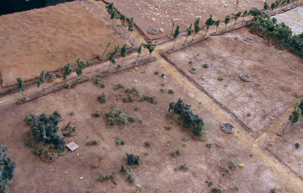 Firing across the broken terrain   The Paras held an advantage here with their extra lmgs and the loss of one Brit section previously. This would set the tone for the entire game, I could put down 4 to 6 dice against William's 3 to 4 dice in these fire fights.