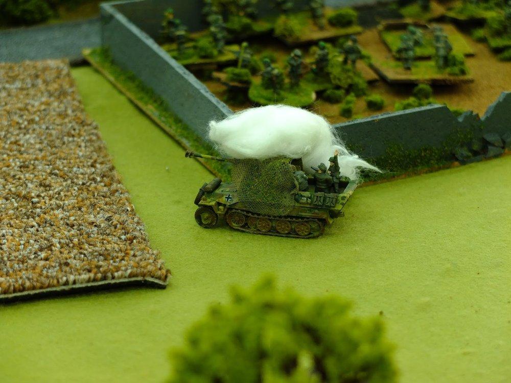 Bazooka fire destroys the half track