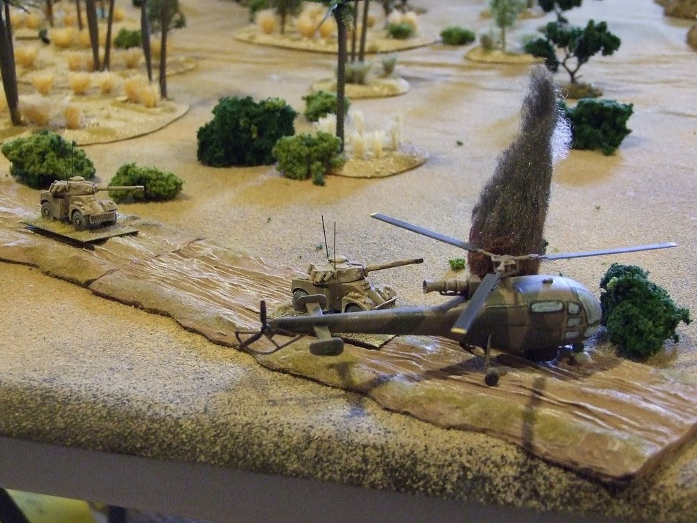 The K-car is shot down by a ZPU-2 as the Eland-90's trade shots with the SWAPO recoilless rifle teams