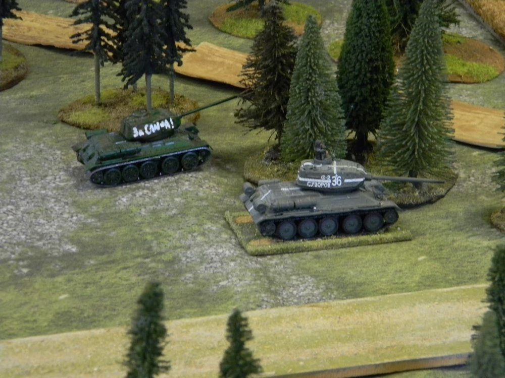 The Soviet tanks try to get to the tree line to get away from the enemy anti-tank guns.