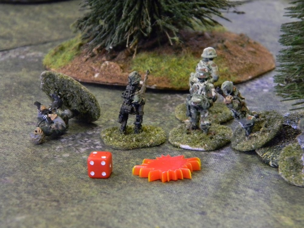 The sniper is good - a kill straight away plus two shocks and the unit is pinned down.