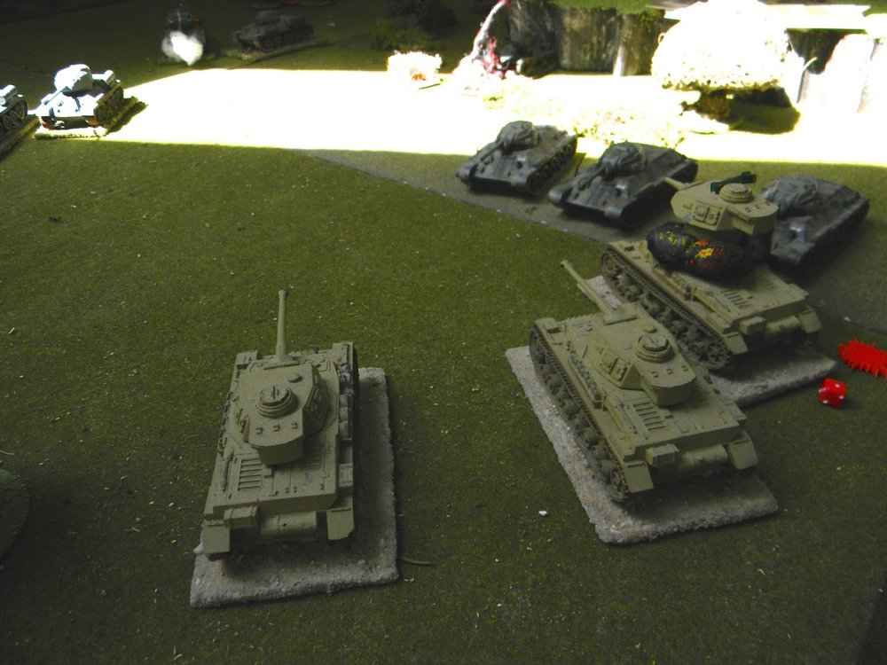 That tank troop keep coming threatening the remaining two Panzers on the German right flank