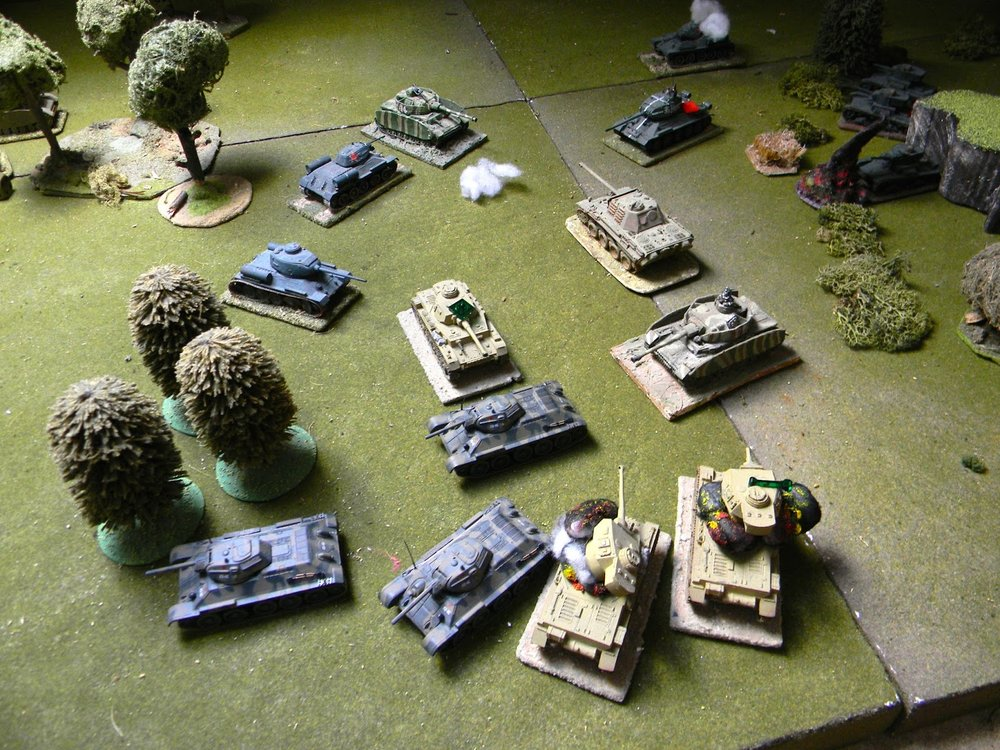 And it turns out to be the German tank CO who crashes through the trees and engages the T34s
