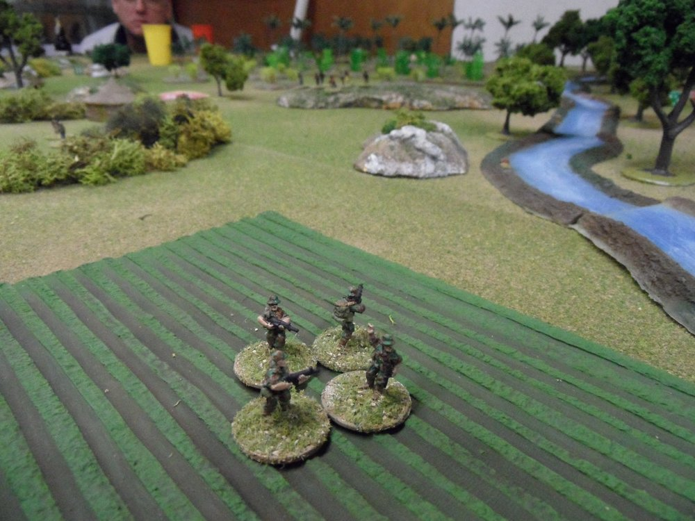 The western squad began to draw fire from the ZANLAs on a distant hilltop: no casualties, little effect
