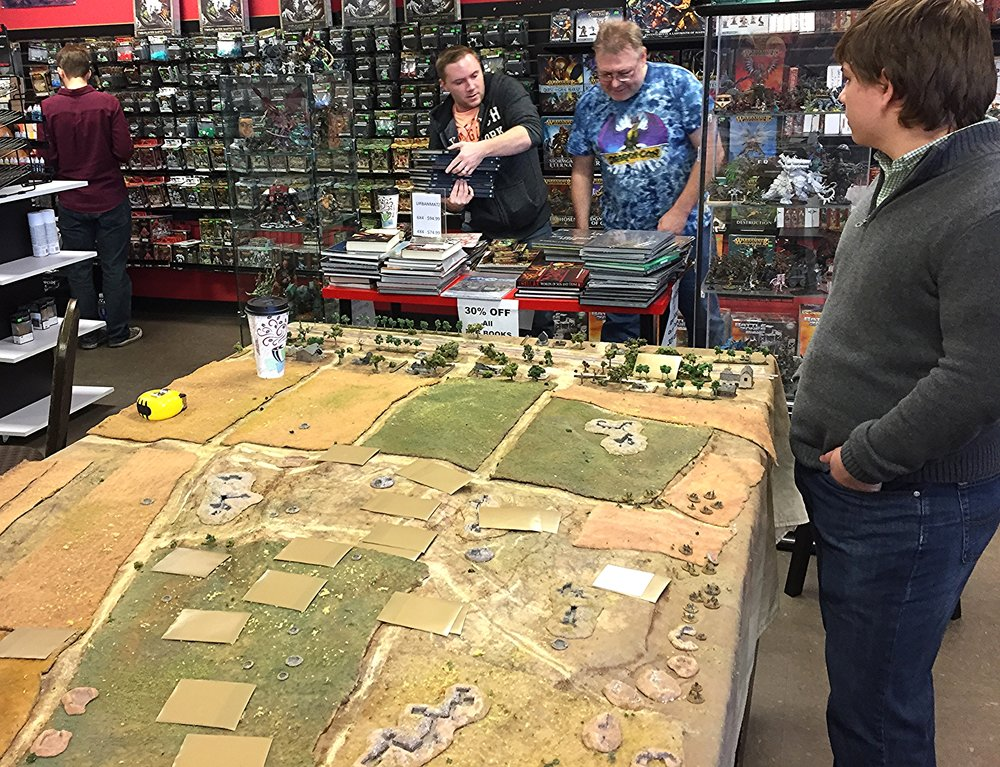 David (Gigabites owner) and Chris S discuss discounted RPG books while Jacob awaits the Soviet onslaught.