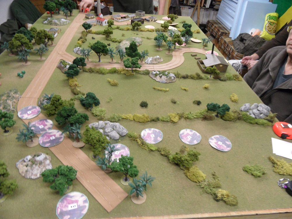At the Government end of the table, looking west, the troops begin to move off-road.