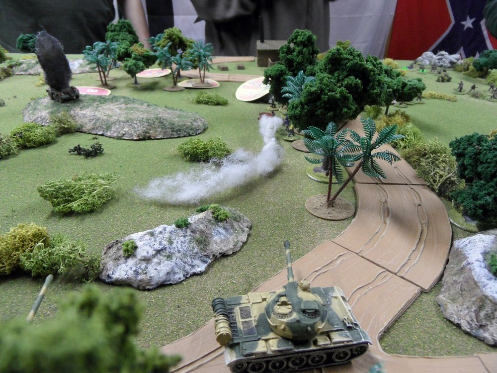 The IMC troops hiding in the trees return fire with an RPG:  it went wildly astray.