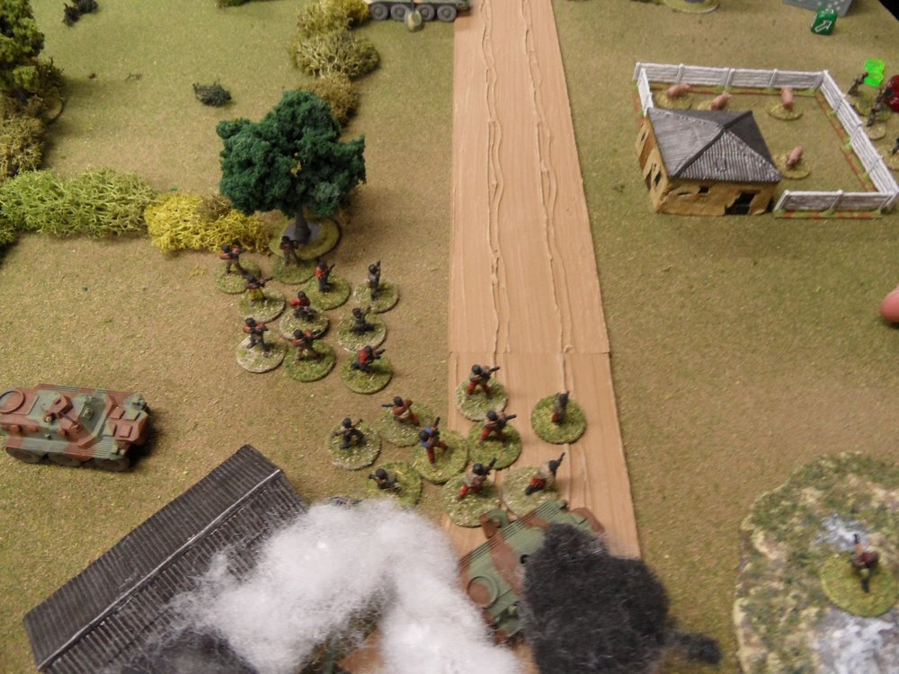 Having spent every available Action on shooting, the IMC troops were literally left standing in the road, desperately hoping their card is drawn before the Government troops get a chance to return fire.