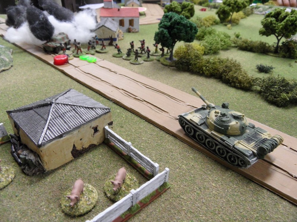 The Government T-55's card came up first and it lashed the rebels with fire.