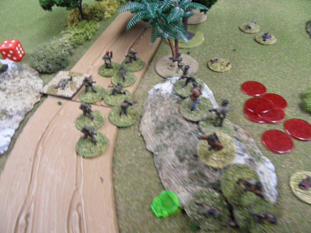 A Government squad (poorly supported by the beaten-down squad on the Hill of Blood) attempts to assault the rebels across the road...