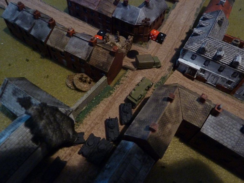 A little later:  the lead Pz II starts ripping up the barricade, the ATR man dies and things look desperate for the Brits!