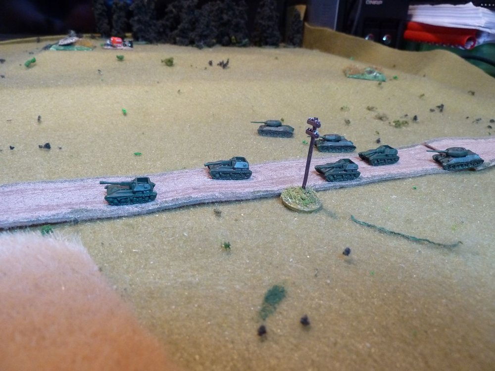 The T-34/85s arrive on the table and dash forward, catching up with the slow moving Su-76s.