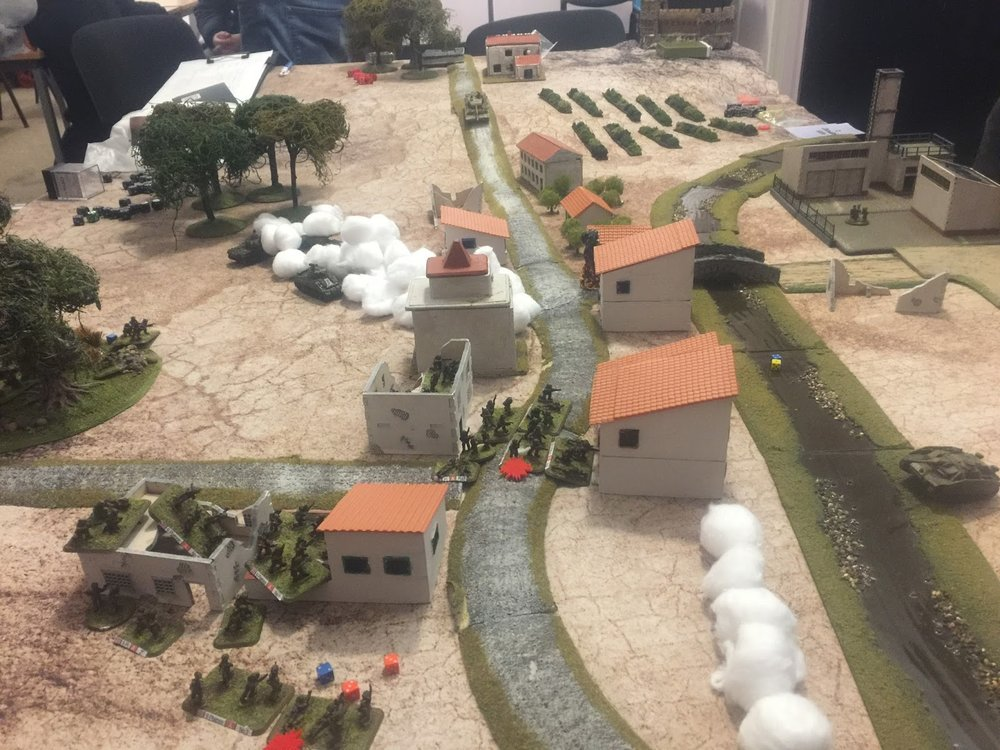Initial assault from the eastern end. Note the large smoke barrage centre table. 7 Platoon close-assaulting across the road centre of picture